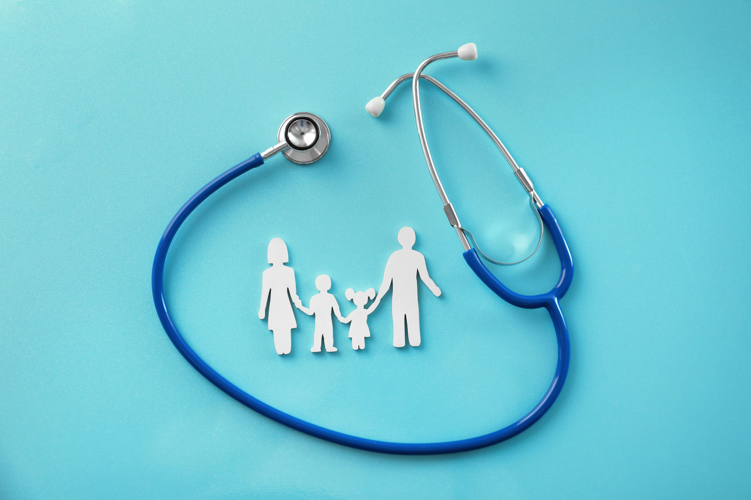 stethoscope with paper cutout of family