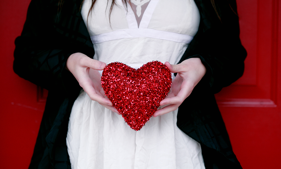 woman holding decorative heart