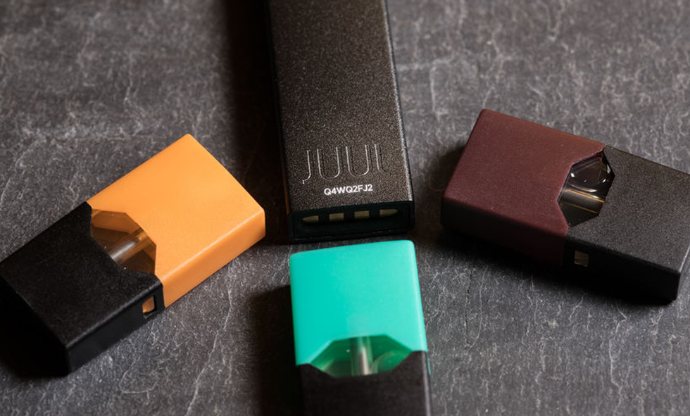 4 juul devices on table