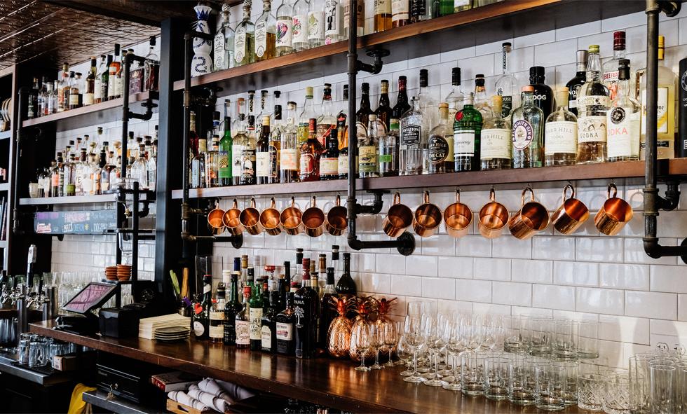 bar shelves full of bottles of alcohol
