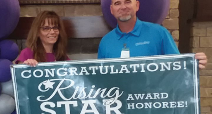 Elvira Webber with Rising Star Award Banner
