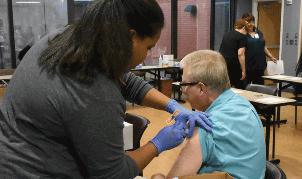 Alan Riddle, Project Manager with IT receives his yearly flu shot during our Annual Flu Vaccination and PPD Clinic.
