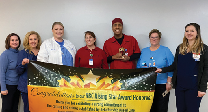 Keanu Ashmore and CCMH Staff with Rising Star Award Banner
