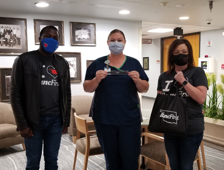BancFirst employees and CCMH nurses with mask strap extenders