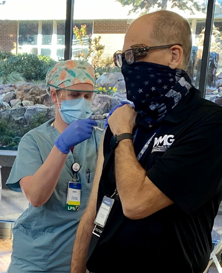 CCMH employee being given new COVID vaccine