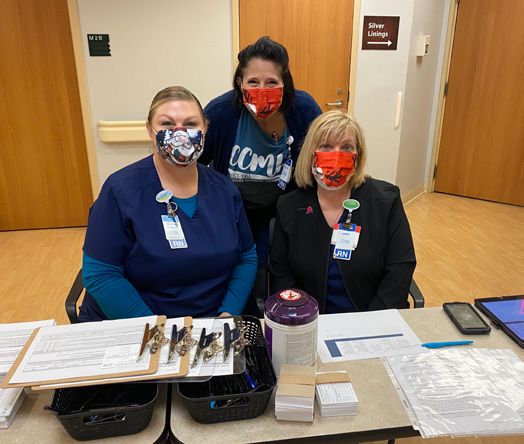 COVID vaccinated CCMH employees posing for picture