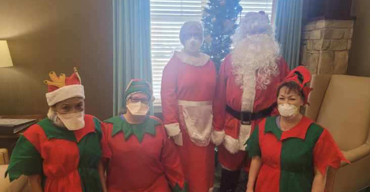 MTNRC employees dressed up as Santa, Mrs. Claus, and Christmas elves