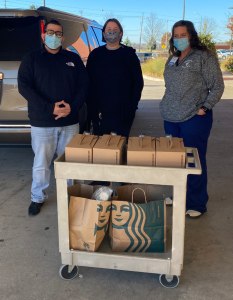 CCMH & Starbucks employees with gallons of Starbucks coffee and bakery treats