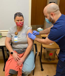CCMH employee receiving COVID-19 vaccine