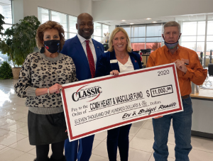 Bridget and Ervin Randle with Classic Chevrolet employees and CCMH donation check