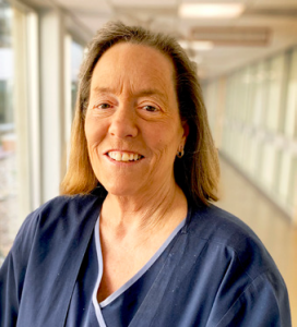 white middle-aged woman wearing CCMH scrubs with shoulder-length light brown hair